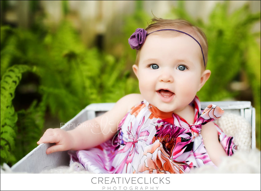 sweet baby girl in garden of ferns