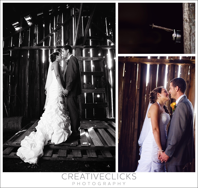 bride and groom in barn ring shot