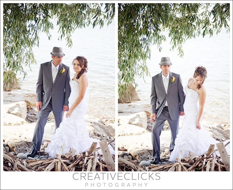 Bride and groom on beach by willow tree