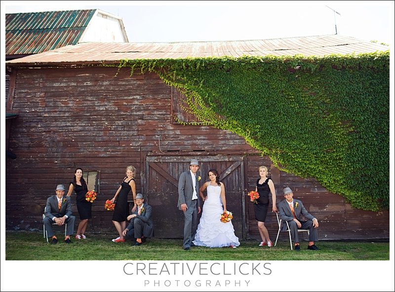 Wedding party by old barn