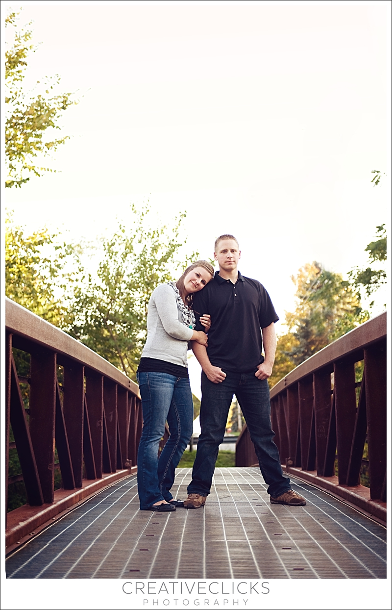 Engaged Couple on Bridge