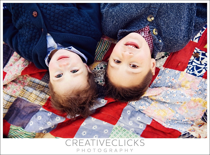 Boys Lying on Antique Quilt