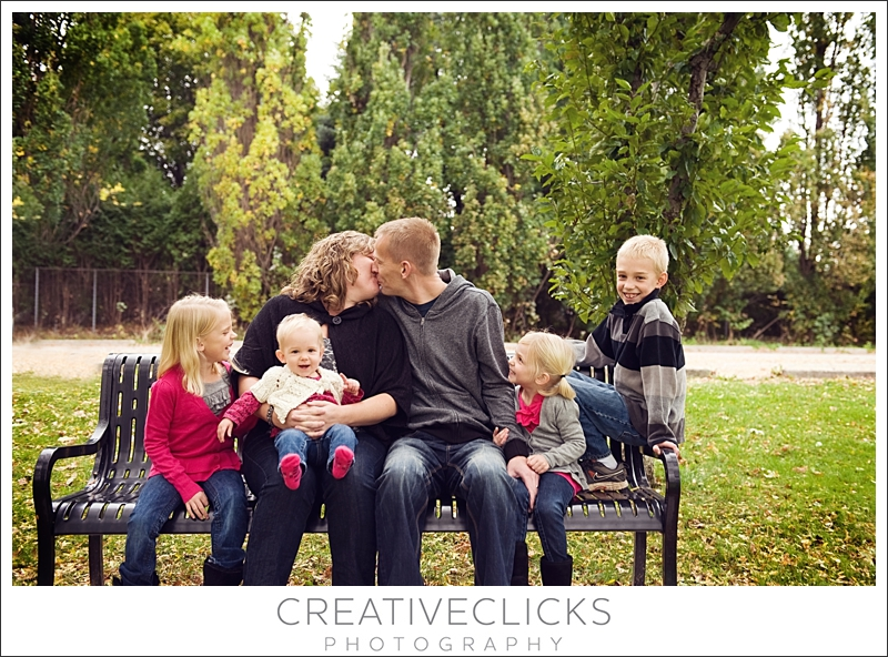Family Sitting on Park Bench