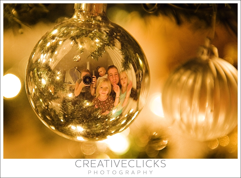 Family Reflection in Christmas Ornament