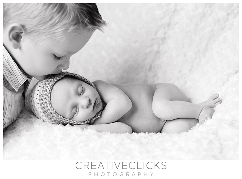 Newborn and sibling image black and white