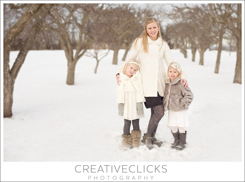 Mother and daughters in the snow