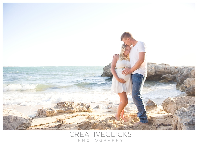 Beach maternity session couples