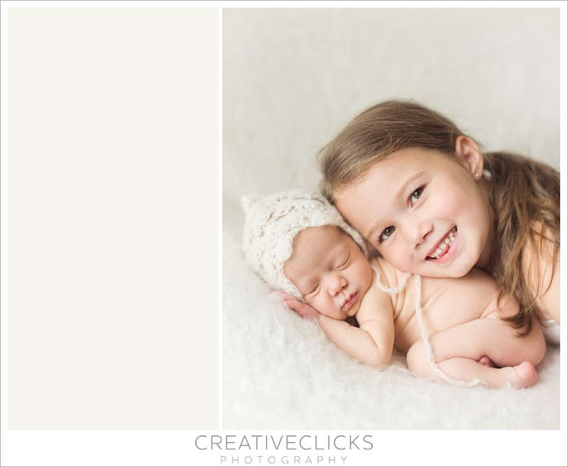 Newborn baby girl with older sister