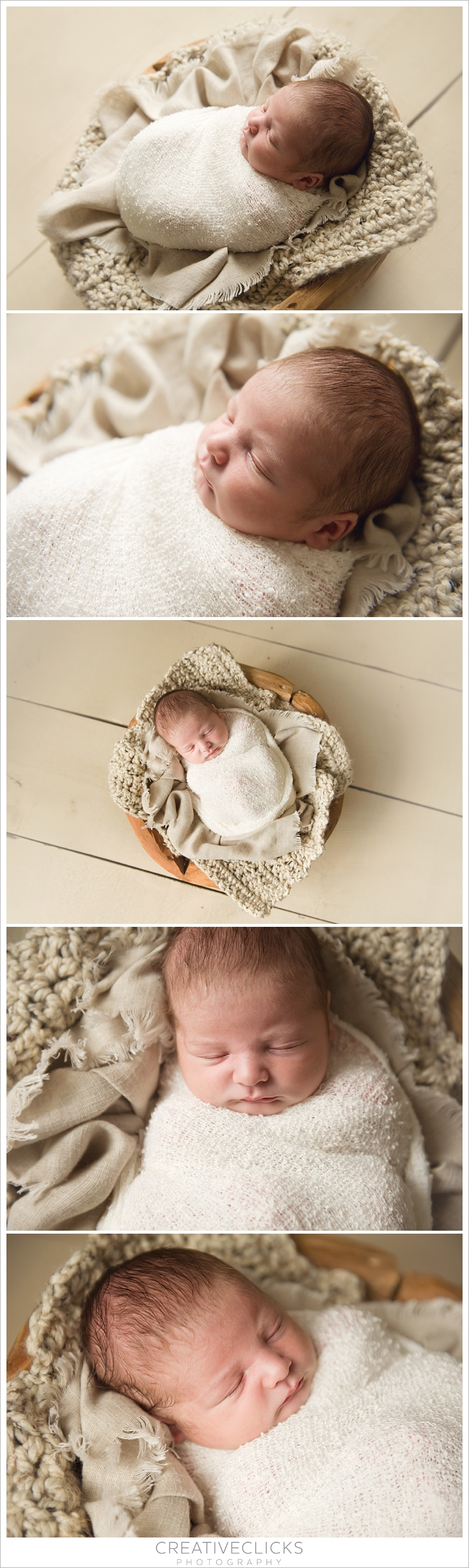 Newborn baby boy wrapped up in wooden driftwood bowl