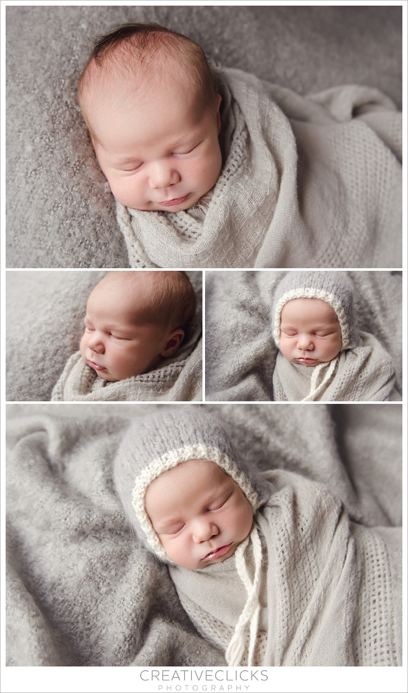 Beautiful newborn baby boy wrapped in soft organic grey wrap and bonnet