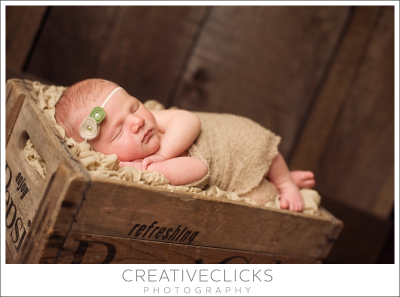 Newborn baby sleeping in pepsi crate