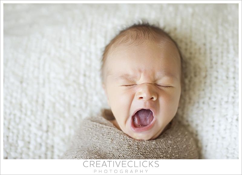 Yawning newborn baby photograph · newborn baby lashes · newborn baby niagara photography